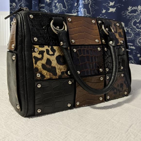 Animal print, studded black top handle bag